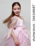 Small photo of Beautiful kid wearing pink dress as a princess