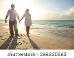 couple walking in sunset time... | Shutterstock . vector #266220263