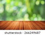 wood desk and bokeh background | Shutterstock . vector #266249687