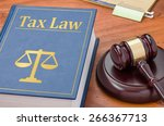 a law book with a gavel   tax... | Shutterstock . vector #266367713
