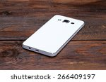 white smartphone lying on a... | Shutterstock . vector #266409197