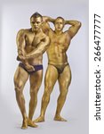 two men in gold paint athletic... | Shutterstock . vector #266477777