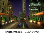 HDR night image of a rooftop terrace in the NYC financial district. Some chromatic aberration is inevitable with this kind of image. - stock photo
