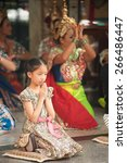 Small photo of BANGKOK,THAILAND - DEM 21 : Unidentified girl make a votive offering the Brahma by present Thai style musical and Thai dancing at Ratchaprasong intersection on December 21, 2014 in Bangkok, Thailand.