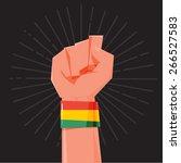 fist hand held high with rasta... | Shutterstock .eps vector #266527583