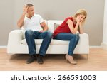 depressed young couple sitting... | Shutterstock . vector #266591003