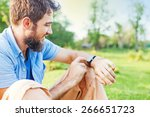 man clicking on a screen of his ... | Shutterstock . vector #266651723