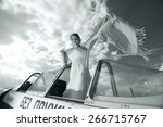 girl in a small plane | Shutterstock . vector #266715767