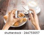 taking photo of fresh baked... | Shutterstock . vector #266753057