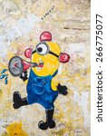 Small photo of GEORGE TOWN,PENANG ,MALAYSIA- CIRCA March 26, 2015: Public street art Name Minion on the wall by Local Artist in Georgetown, Penang, Malaysia.