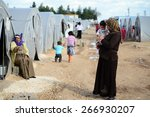 syrian people in refugee camp... | Shutterstock . vector #266930207