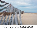 Gray And Weathered Storm Fence...