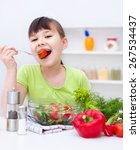 cute girl make vegetable salad | Shutterstock . vector #267534437