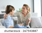 mother giving warning to young... | Shutterstock . vector #267543887