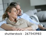 mature couple sitting in sofa ... | Shutterstock . vector #267543983