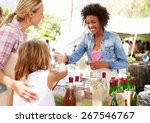 Woman Selling Soft Drinks At...