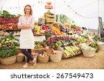 Female Stall Holder At Farmers...