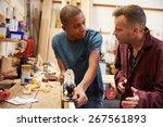 Carpenter With Apprentice...