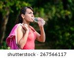 a girl drinks water after sport | Shutterstock . vector #267566117