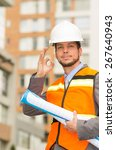 Small photo of young handsome architect supervising a construction gesturing all right
