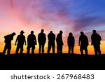 silhouettes of people on the...