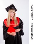 Small photo of Educational theme: graduating student girl in an academic gown. Isolated over white background.
