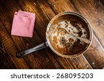 dirty pan after a dinner on a...   Shutterstock . vector #268095203