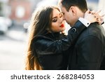 beautiful young couple tenderly ... | Shutterstock . vector #268284053