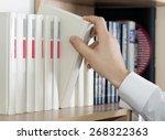 choosing book. hand of man in... | Shutterstock . vector #268322363