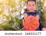 happy asian boy holding... | Shutterstock . vector #268331177