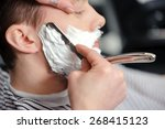 skillful barber. young man... | Shutterstock . vector #268415123