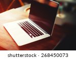 workplace with open laptop with ... | Shutterstock . vector #268450073