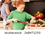 mother and child in the kitchen   Shutterstock . vector #268471253