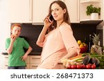 mother and child in the kitchen   Shutterstock . vector #268471373