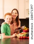 mother and child in the kitchen   Shutterstock . vector #268471397