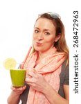 woman making a smoothie   Shutterstock . vector #268472963