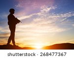 armed soldier with rifle... | Shutterstock . vector #268477367