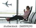 girl at the airport window | Shutterstock . vector #268599293