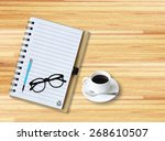 notebook with office supplies... | Shutterstock . vector #268610507