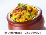 chicken biryani in clay pot | Shutterstock . vector #268649027