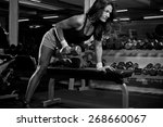 woman with barbells in the gym  ... | Shutterstock . vector #268660067