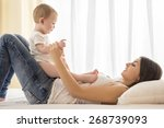 happy mother with her little... | Shutterstock . vector #268739093