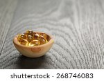 Fish Oil Capsules In Wood Bowl...