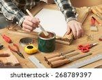 decorator varnishing a wooden... | Shutterstock . vector #268789397