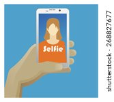 selfie icon with smart phone ... | Shutterstock .eps vector #268827677