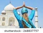 young woman meditating at taj... | Shutterstock . vector #268837757
