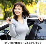 pretty girl showing the car key  | Shutterstock . vector #268847513