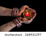 woman hands with henna holding... | Shutterstock . vector #268931297