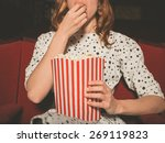 a young woman is watching a... | Shutterstock . vector #269119823