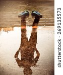 the man reflection in the water ... | Shutterstock . vector #269135573